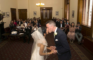 Image of a couple getting married in the Margaret Craig room at the Old Treasury Building